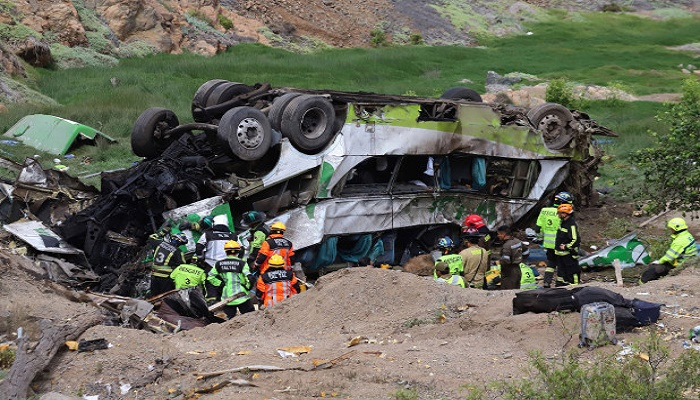21 killed in north Chile after bus plunges into ravine