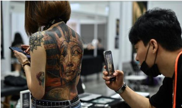 Malaysian minister criticises 'obscene' tattoo show in Kuala Lumpur