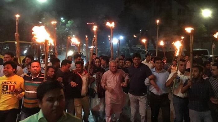BNP brings out torch procession demanding Khaleda's bail
