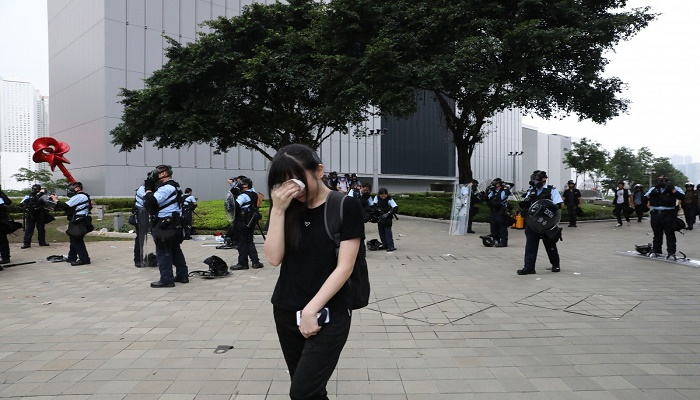 Hong Kong police warn against teachers leading students into violent acts