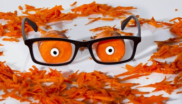 How do carrots affect vision?