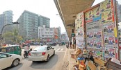 Posters, graffities hurt Dhaka's beauty