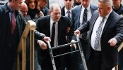 Harvey Weinstein charged with rape in LA as New York trial begins