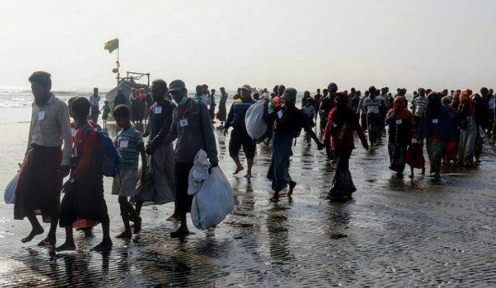 Myanmar sends nearly 200 Rohingya captured at sea to Rakhine camps