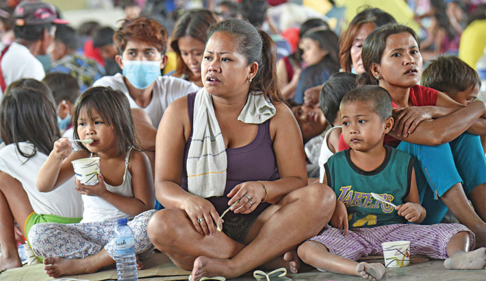 Tens of thousands face uncertainty as Philippine volcano spews lava