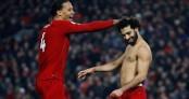 Liverpool beat Man Utd 2-0 to tighten grip on title
