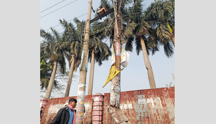 The badly damaged electricity pole holding a transformer