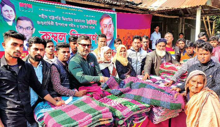 Distributes warm clothes among cold-hit poor peopl