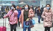 China warns against travel to virus-hit Wuhan city