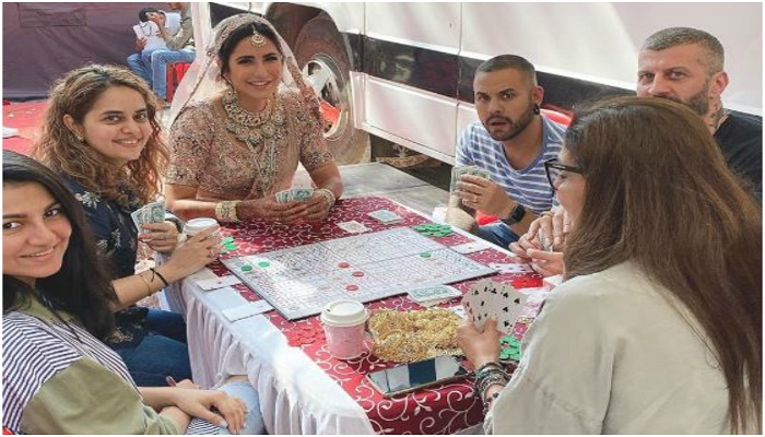 Katrina Kaif playing cards in bridal with team members