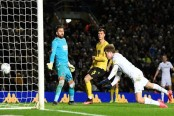 Leeds back on top of Championship, Rooney scores for Derby