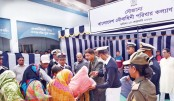 Bangladesh Navy Family Welfare Association distributes foods and blankets