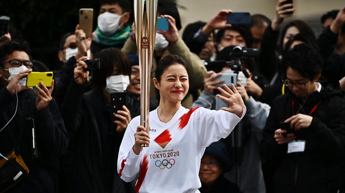 Tokyo holds Olympic torch rehearsal as spectre of coronavirus looms