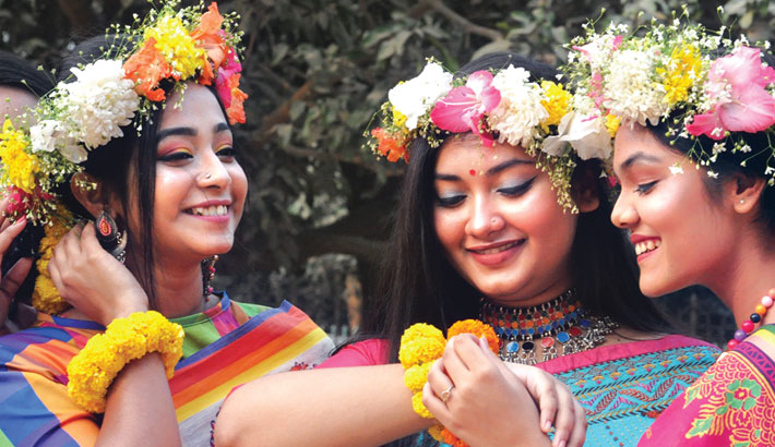 Girls bedecked with colourful flowers