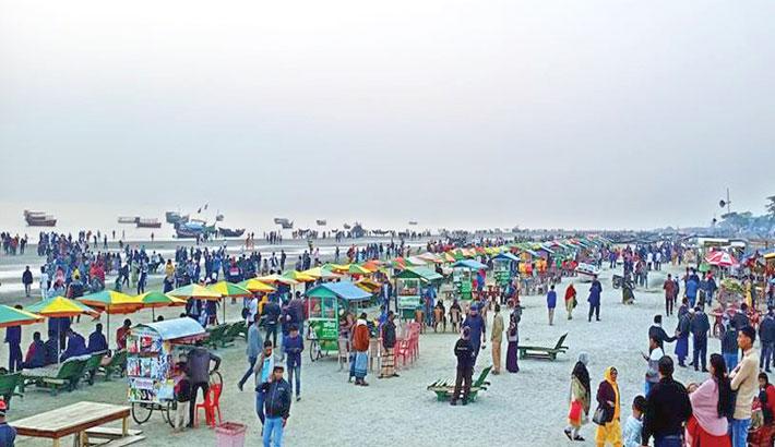 People crowd the Kuakata sea beach in Patuakhali
