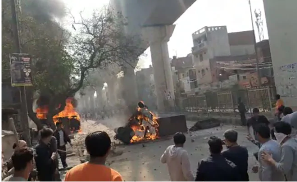 Clash over CAA in Delhi hours before Trump's visit, vehicle set on fire