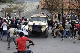 2 dead after protesting Haiti police exchange fire with troops: reports