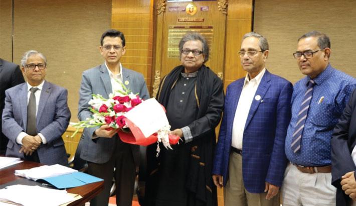 Education Secretary Md Mahbub Hossain receives a bouquet