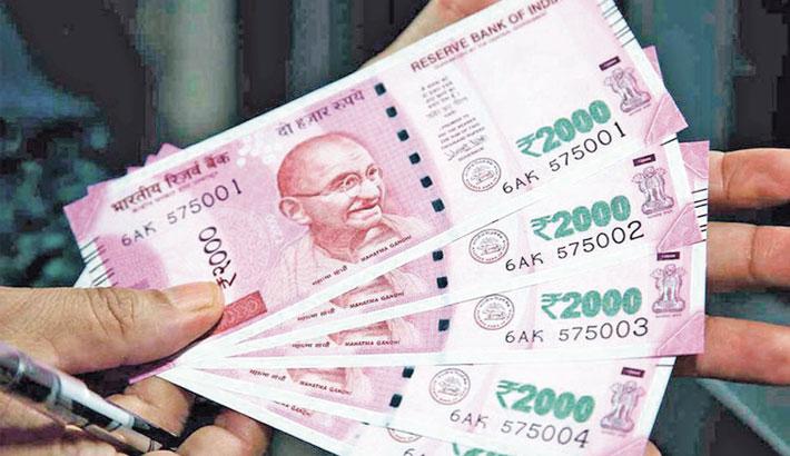 Rupee gains 20 paise against dollar