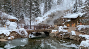 A snowy hot springs where clothing is optional after dark
