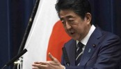 Japan's leader announces $2.5B package to help fight virus