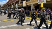 Fired security guard takes dozens hostage at upscale mall in Philippines