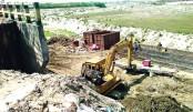 Rajuk building bridge destroying crop land