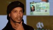 Brazilian football great Ronaldinho arrested over alleged passport fraud in Paraguay