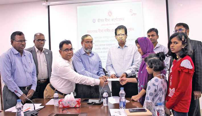 Chairman of Jiban Bima Corporation hands over the posthumous cheques