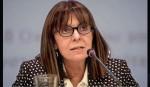 Greece hands reins to 1st woman president
