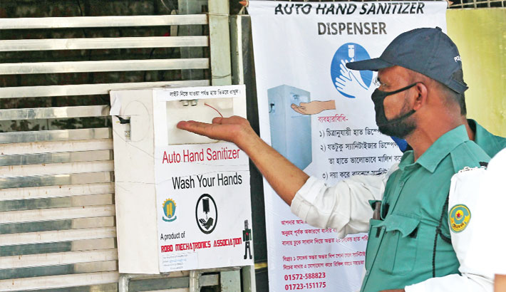 Traffic constable uses sanitizer