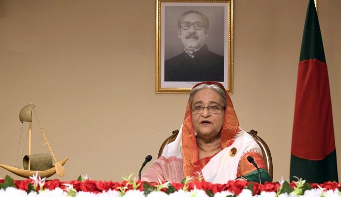 PM announces Tk 5,000 cr in virus fund for workers' wage