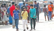 Children are seen walking in group without safety equipment