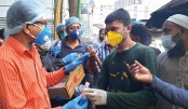 Udichi distributes hand sanitisers