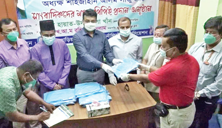 Distributes personal protective equipment among the local journalists
