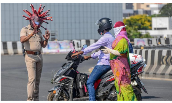 Indian police officer warns people wearing coronavirus helmet