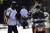 Indonesia declares state of emergency as coronavirus toll jumps