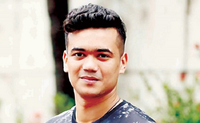 Cricketer Taskin Ahmed stands beside people