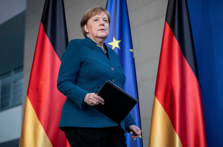 Angela Merkel returns to work after self-quarantining