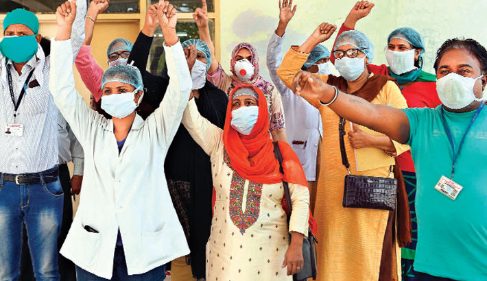 Medical staff shout slogans as they demand PPE and coronavirus testing kits