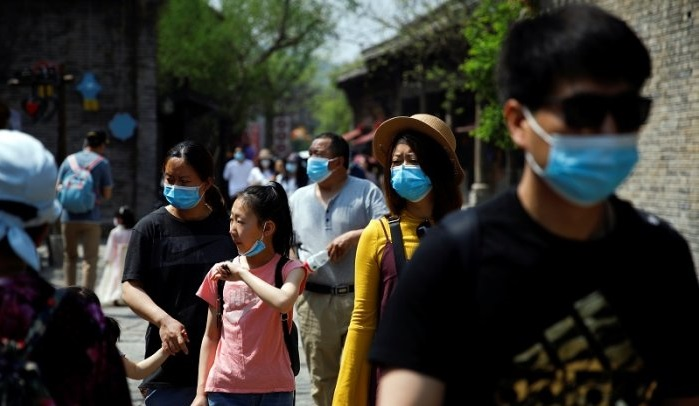 WHO wants invite to China's probe into virus origins