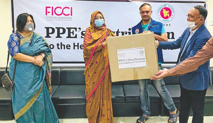 FICCI donates  11,000 PPE  to DGHS