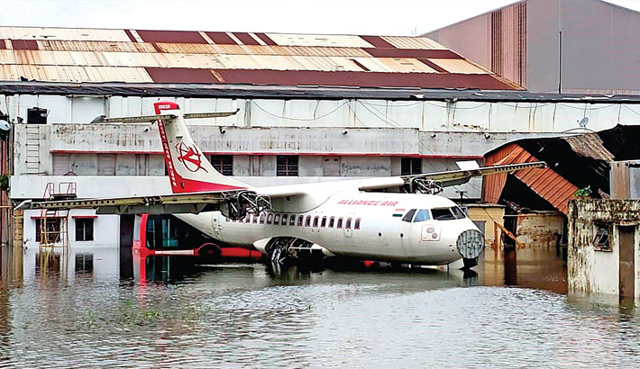 An aircraft is parked at the flooded