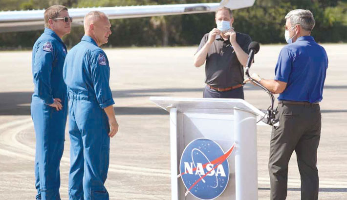 NASA astronauts arrive in Florida week before SpaceX flight
