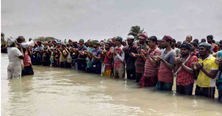 Thousands offer Eid prayers standing in water