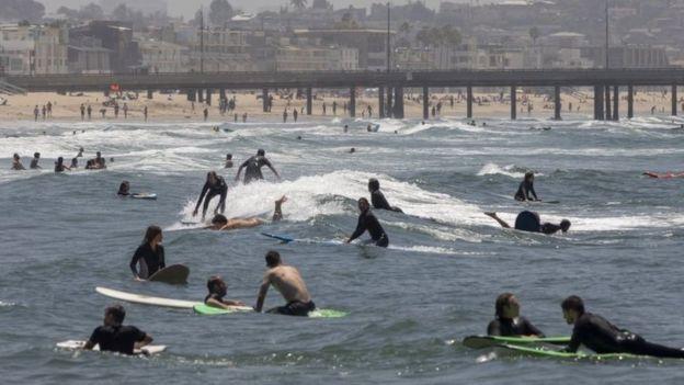 Coronavirus: Americans flock to beaches on Memorial Day weekend