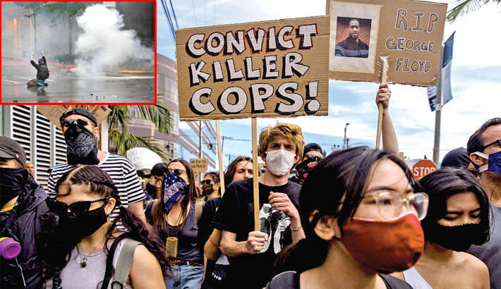 Demonstrators march to protest against the death of George Floyd