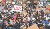 US protesters defy curfews