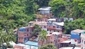 Thousands still risk living on hill slopes