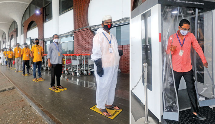 Passengers enter Hazrat Shahjalal International Airport in the capital through a disinfection channel
